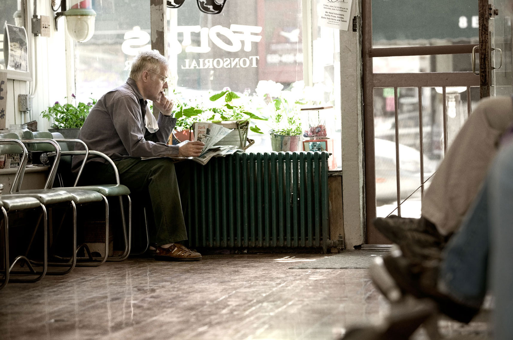 Barber reading a newspaper