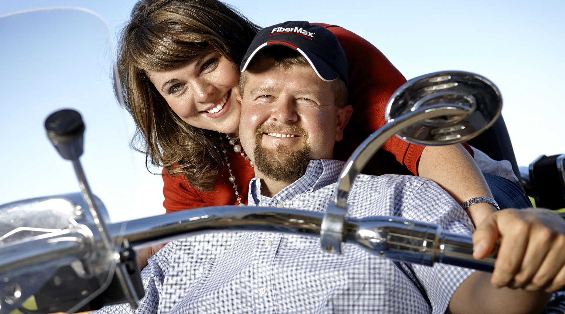 Newlywed couple on a motorcycle.