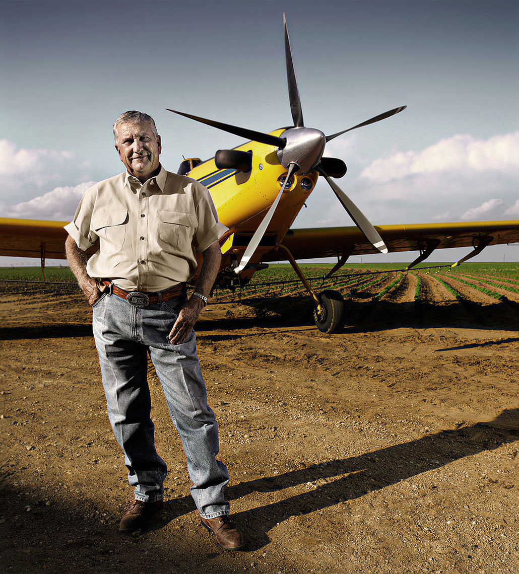 Crop duster pilot Benny White standing in front of his airplane.