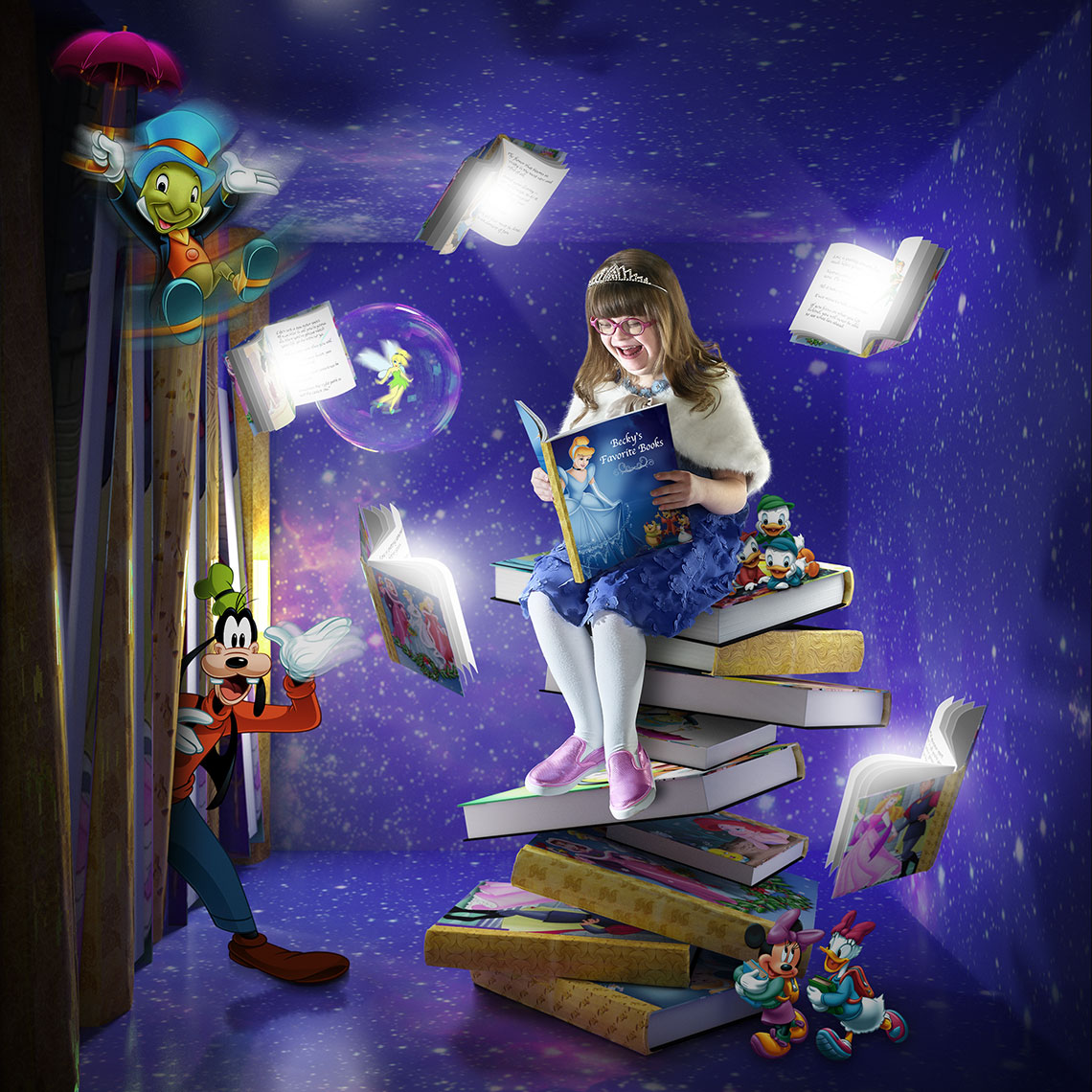 Young girl reading Disney books