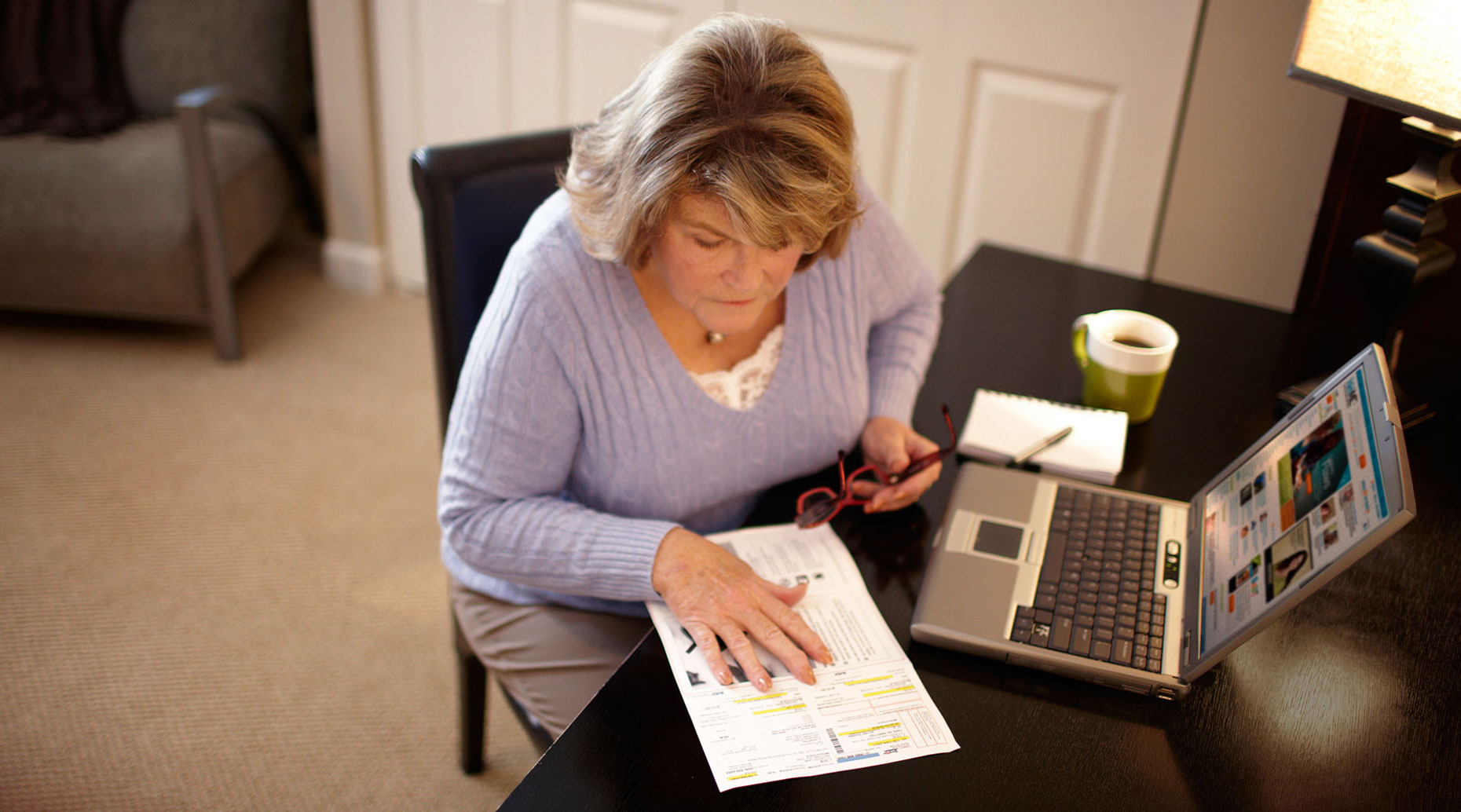 Elderly patient viewing her prescription information.