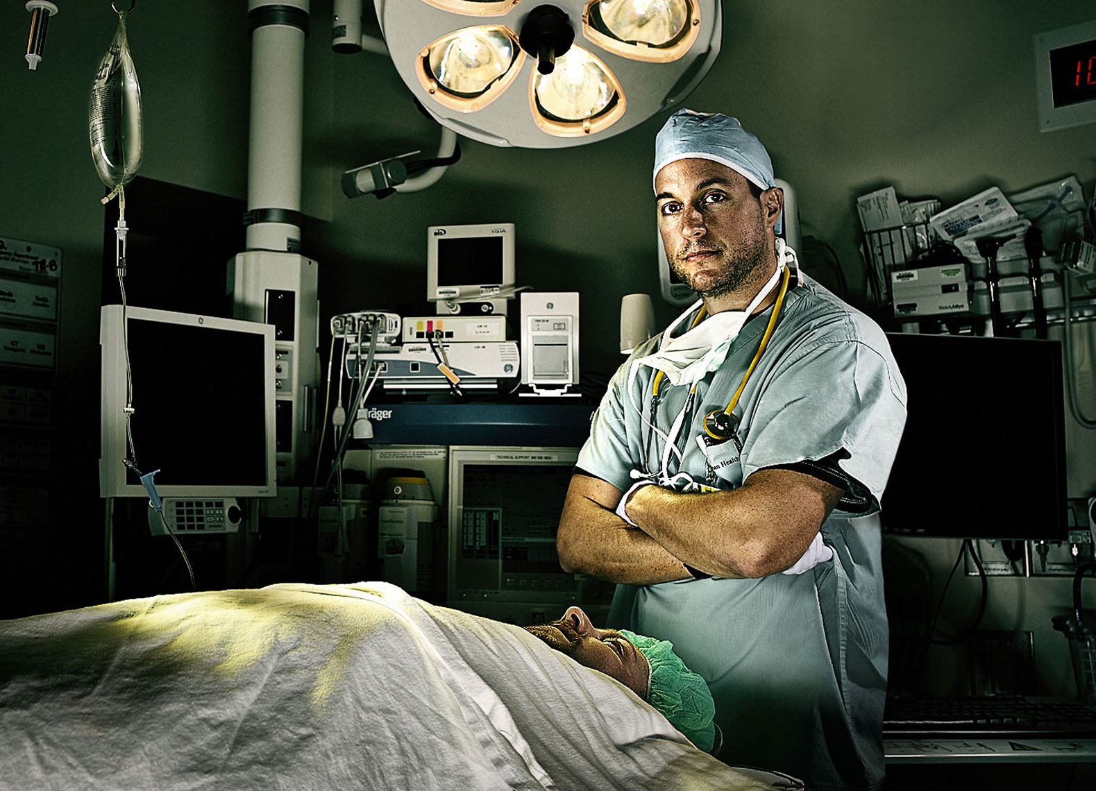 Anesthesiologist and patient in a surgical suite.