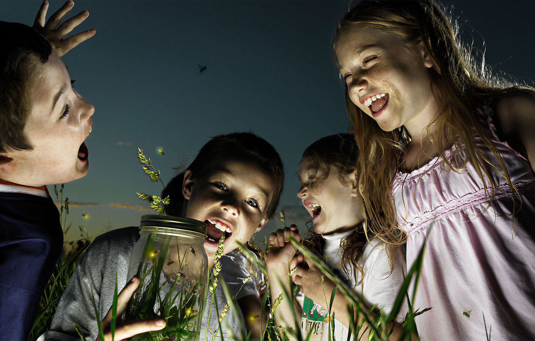 Children capturing fireflies