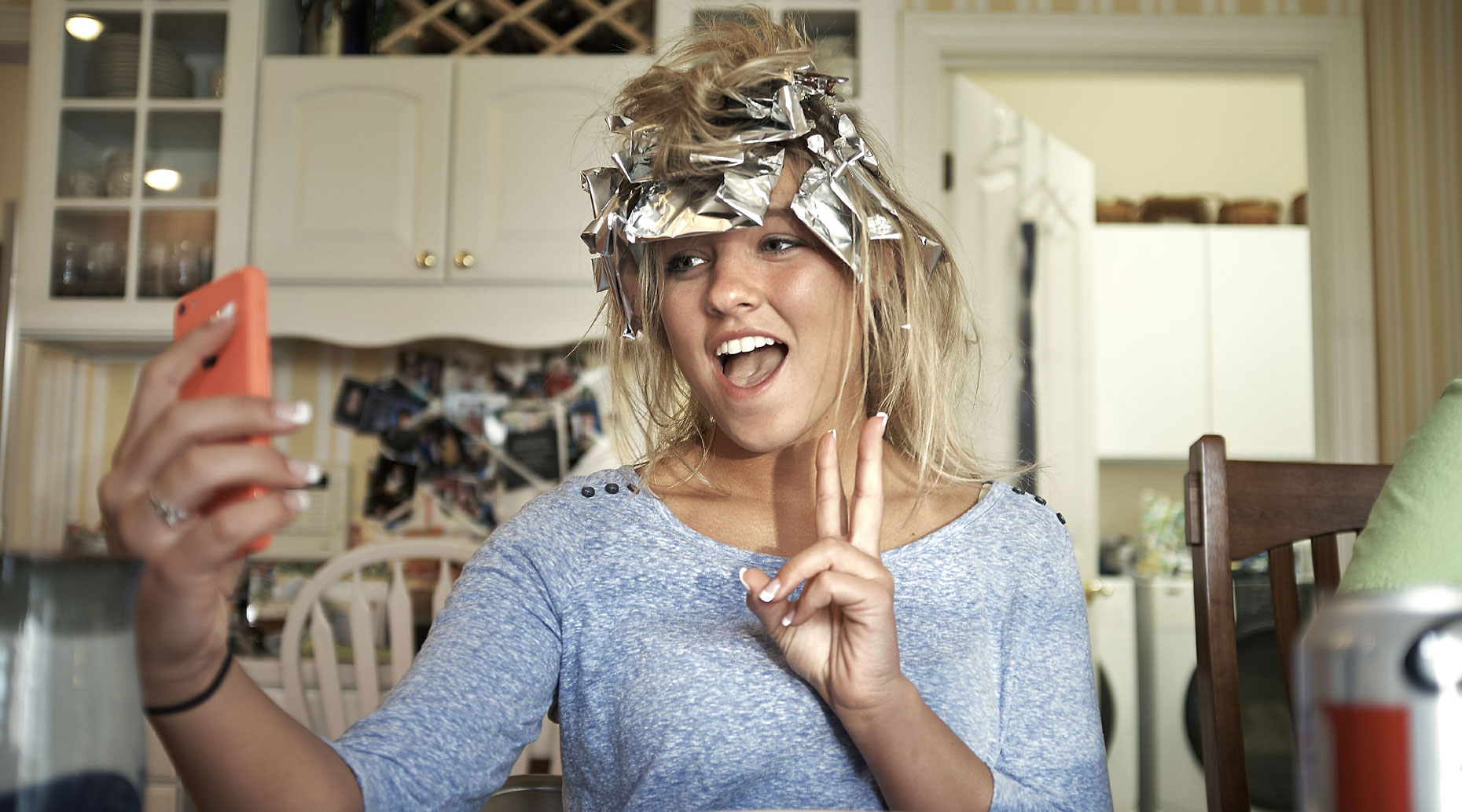 Young girl with tin foil in her hair.