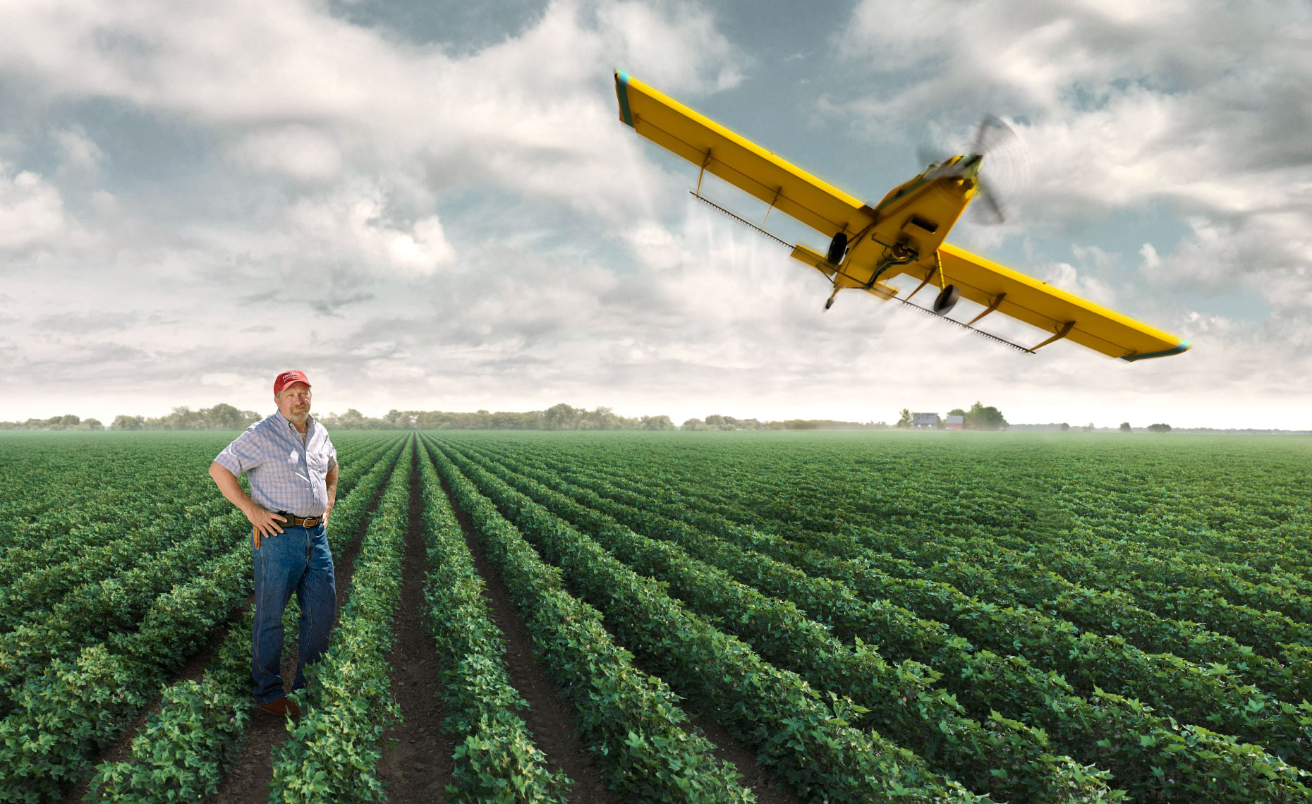 Cotton farmer in his cotton field with CGI crop duster in West Texas.