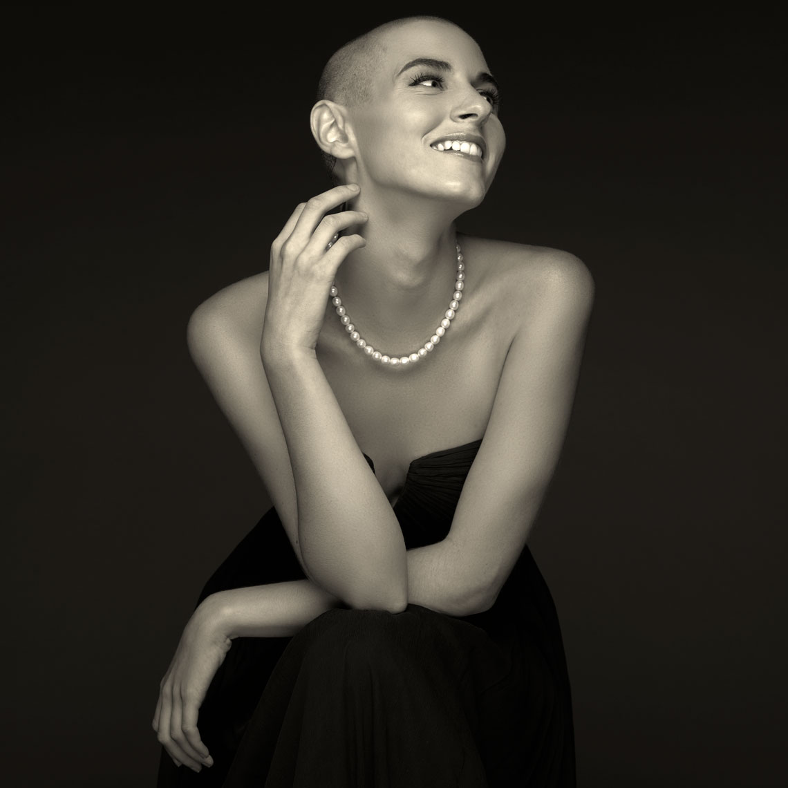 Happy bald young woman