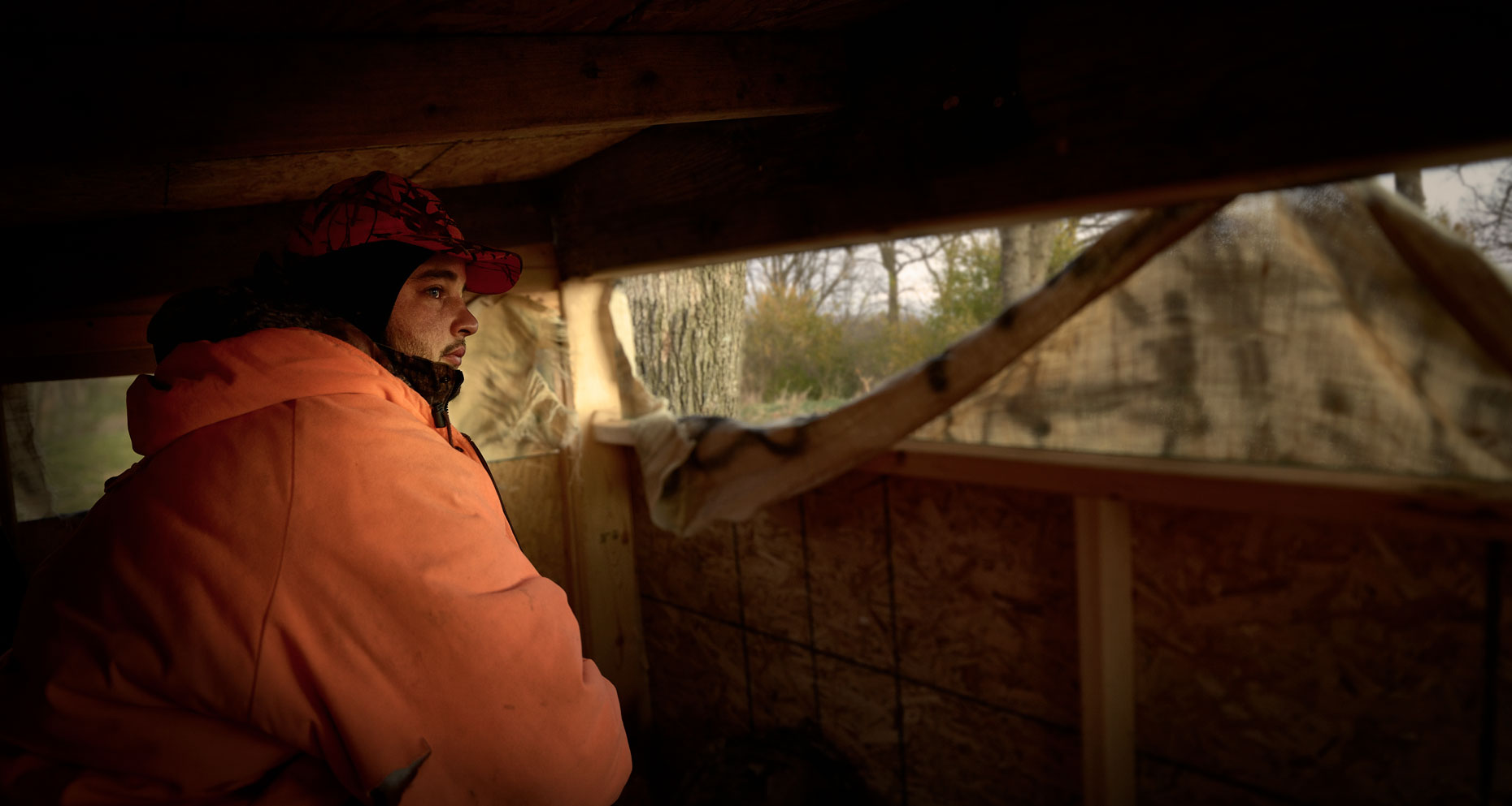 Young man in a duck blind.