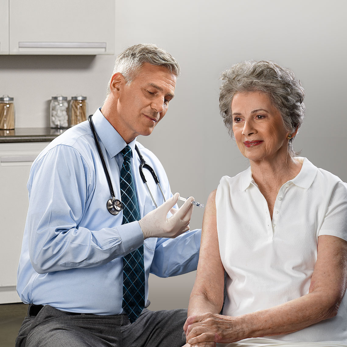 Doctor giving a flu shot to a patient