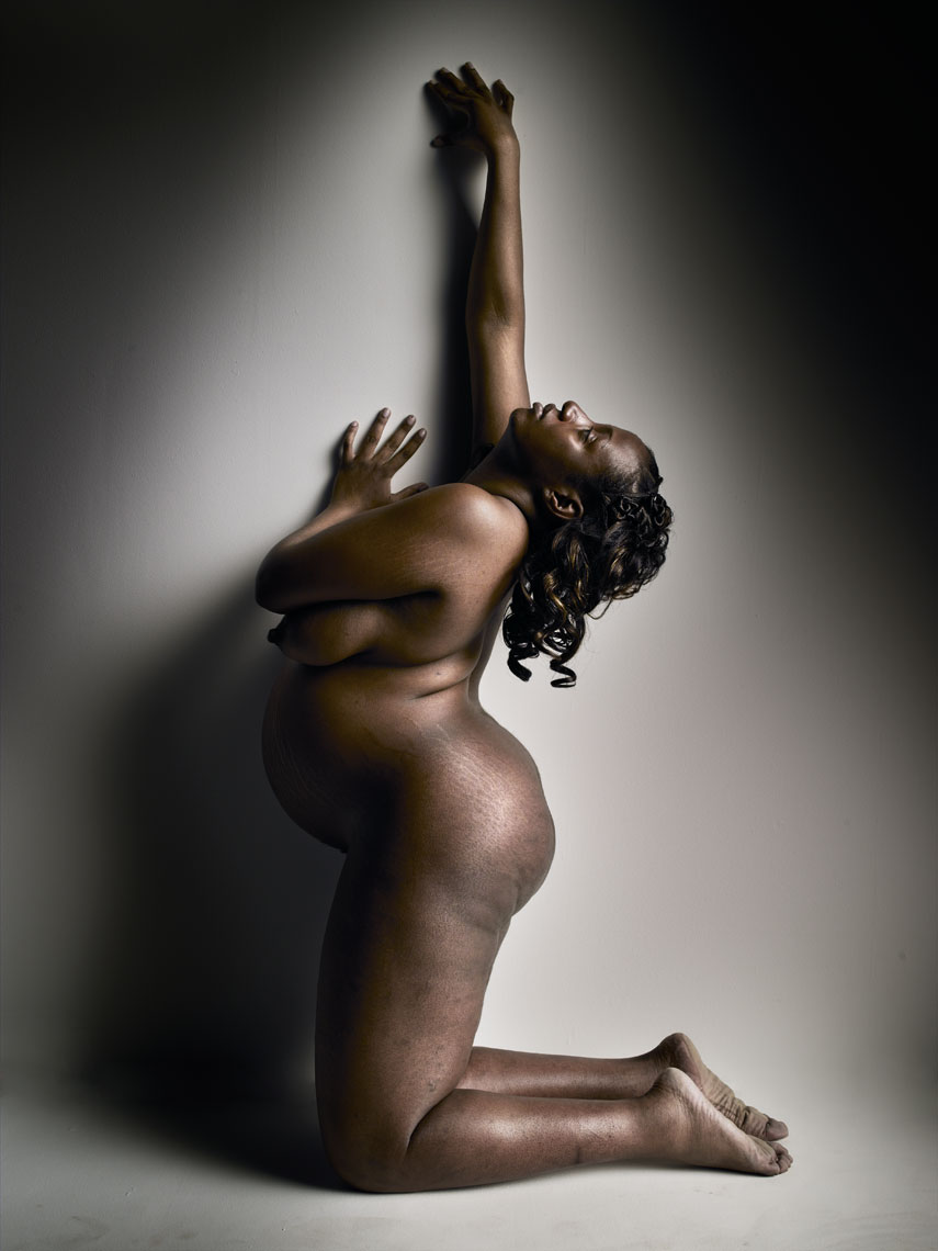 Conceptual portrait of a pregnant woman